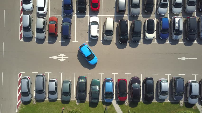 AERIAL TOP DOWN, TIMELAPSE: Bad driver incapable to park a car on parking space in big crowded parking lot. Female having problems, unable to park a car in parking spot. Parking fail on park space | Shutterstock HD Video #30572224
