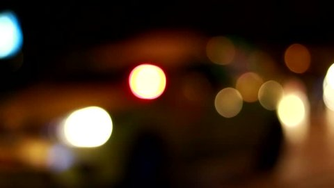Defocus light from night traffic with flare Bangkok street