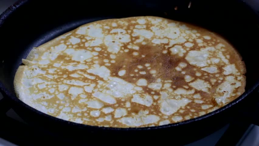 Process of making delicious milk pancakes in a pan stock footage process of making delicious milk pancakes in a pan hd stock video clip ccuart Image collections