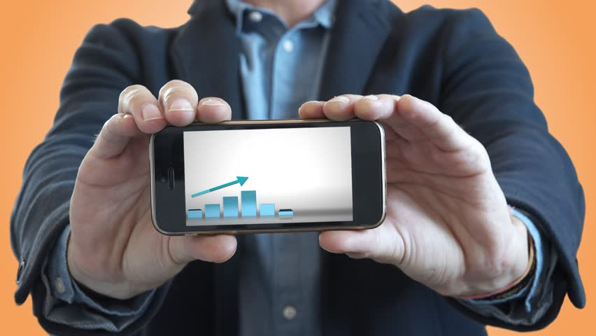 Business Success Presentation In Smartphone. Man holding a smartphone with a positive chart in a business presentation | Shutterstock HD Video #30620635