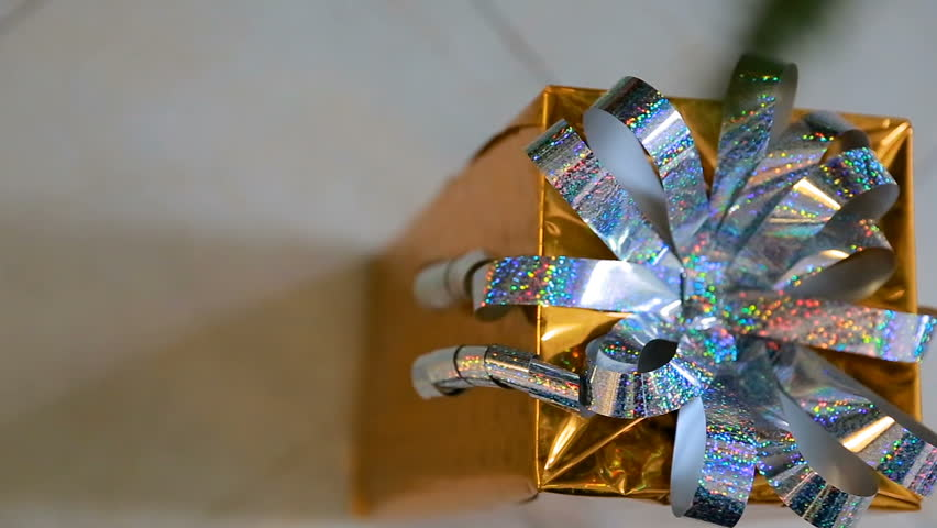 Golden christmas gift Under the Christmas Tree. Christmas gift box with nice ribbons