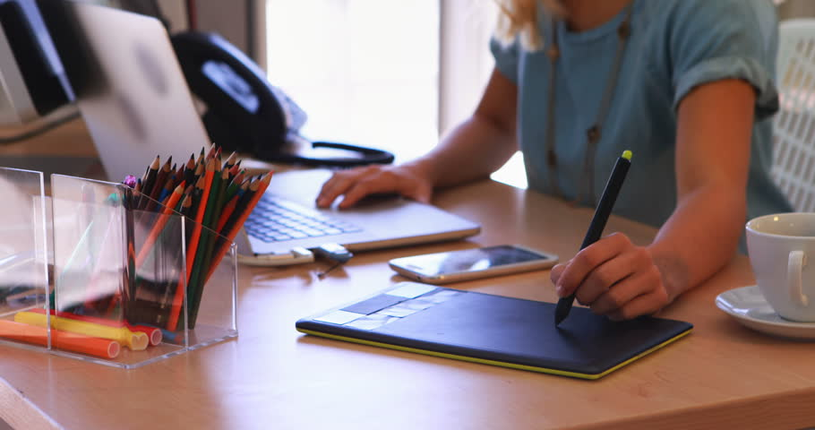 Female executive working over graphic tablet at her desk in office 4k   Shutterstock HD Video #30697000