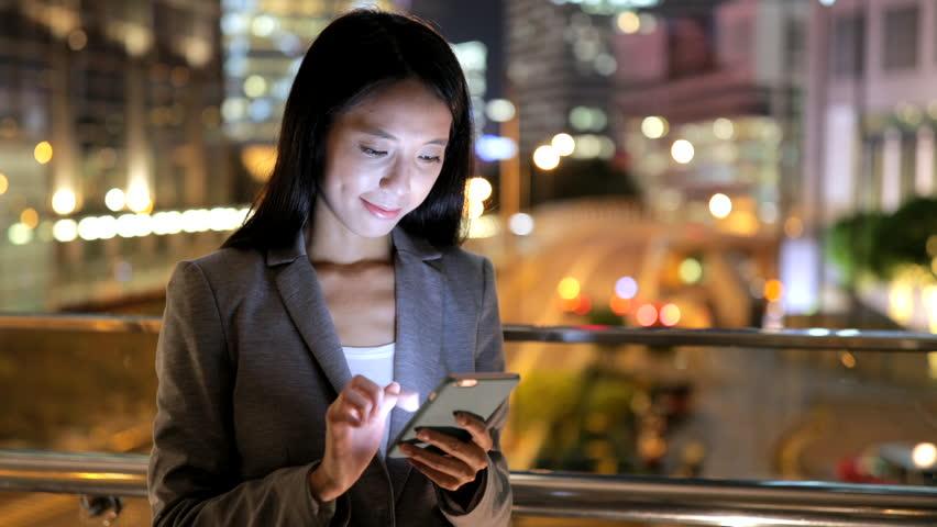 Business woman using smart phone in Hong Kong city  | Shutterstock HD Video #30705160