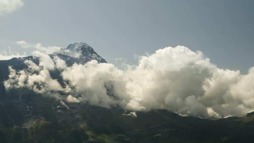 Time lapse clouds float in the valley under the iconic swiss mountain Eiger near Grindelwald village Bern region Switzerland Alps travel Europe wanderlust