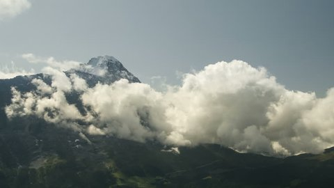 Time lapse clouds float in the valley under the iconic swiss mountain Eiger near Grindelwald village Bern region Switzerland Alps travel Europe wanderlust