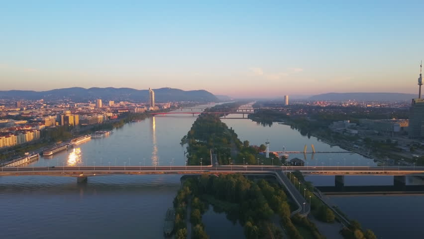 vienna aerial shot,flying over danube river at sunrise
