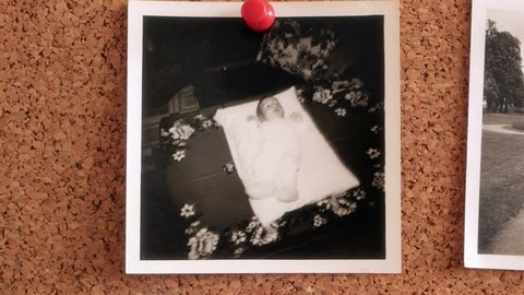 Childhood memories - Photos of a young boy on a cork pinboard