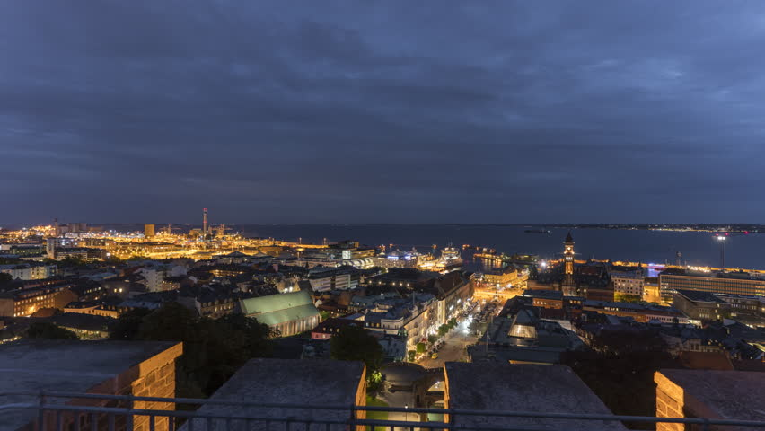 Timelapse Panorama View Of Helsingborg at night, Sweden. 4K, 25p