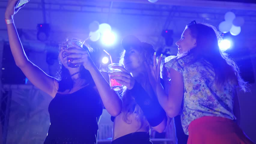 self photo of sexy women With bright drink at disco club, dancing at party in lumiere lights,   #30828430