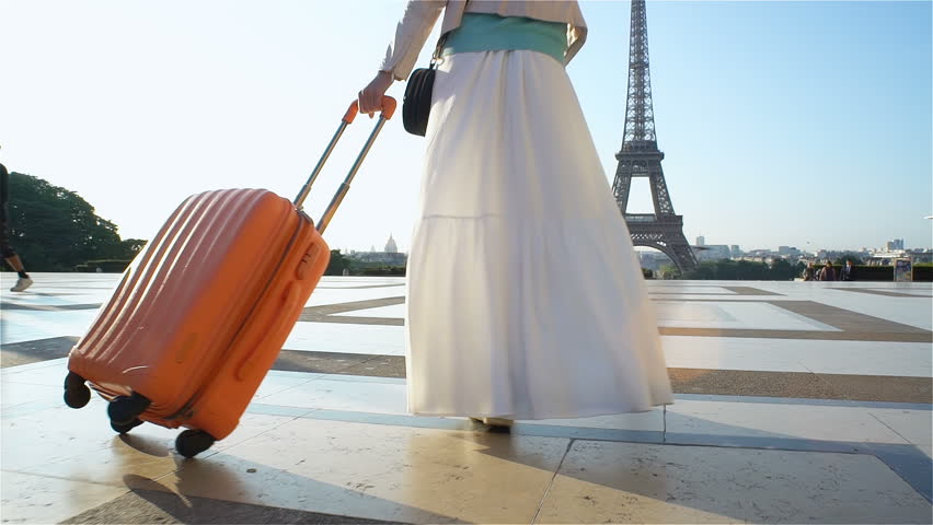 Young Woman with the Orange Suitcase Traveling to Paris. Eiffel Tower Background. | Shutterstock HD Video #30867838