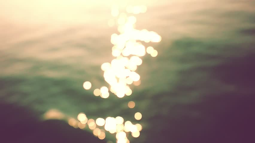 Glistening and shimmering ocean surface at sunset or twilight. Beautiful bokeh of dancing sun reflections on water in slow motion. 1920x1080 | Shutterstock HD Video #30869890