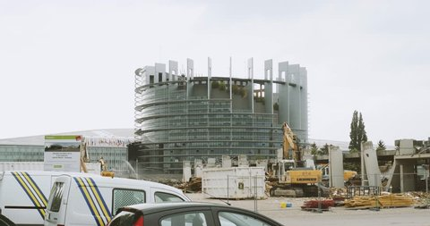 STRASBOURG, FRANCE - CIRCA 2016: Construction site with European Parliament Headquarter building in Strasbourg in the background with Liebherr excavator working
