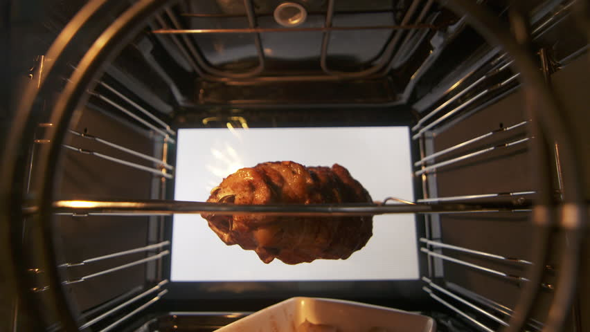 Cooking Spit Rotisserie Pork Sirloin Roast In Hot Convection Oven Timelapse View From Inside The