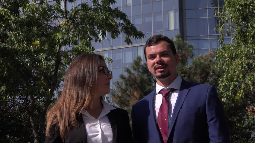 Executive couple business meeting outside office man woman walking discussing 4K   Shutterstock HD Video #30902980