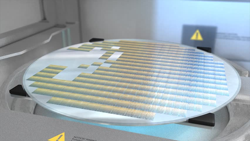 Separating a silicon wafer into individual die.