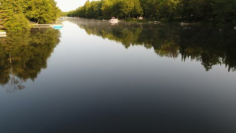 Low Altitude to High tracking shot over the Muskoka River