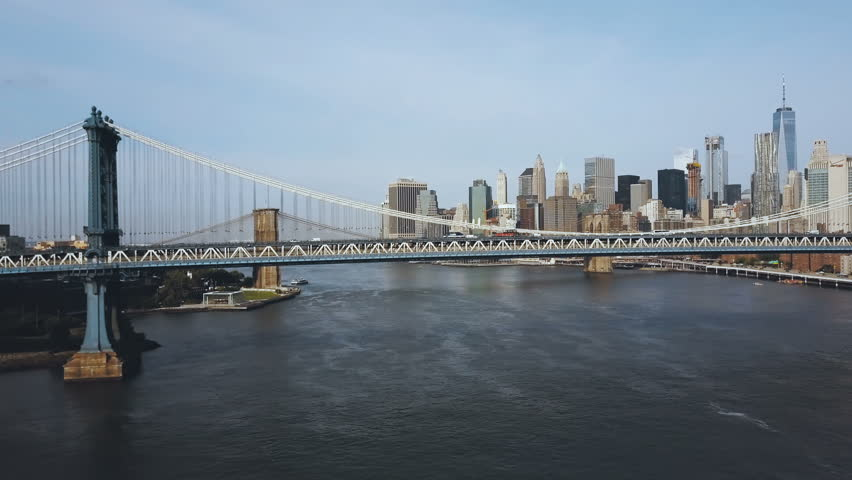 Aerial view of the Manhattan bridge through the East river. Drone flying near the road in New York, America. | Shutterstock HD Video #30989938