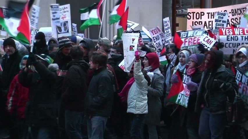 "Chicago - 1/9/09 - Pro Hamas supporters with thousands of flags & signs march to the Chicago Israeli consulate shouting ""Free Free Palestine"" and ""Long live Palestine""  etc."