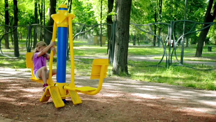 Little beautiful girl engaged on sports training apparatus in summer city park. | Shutterstock HD Video #31002907