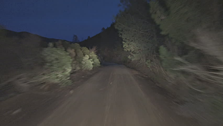 Driving POV shot, Mendocino National Forest, Bartlett Springs Road, dirt, at