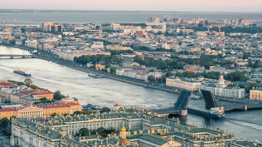 Aerial shot of the floating barge on the river Neva under the bridge | Shutterstock HD Video #31020460