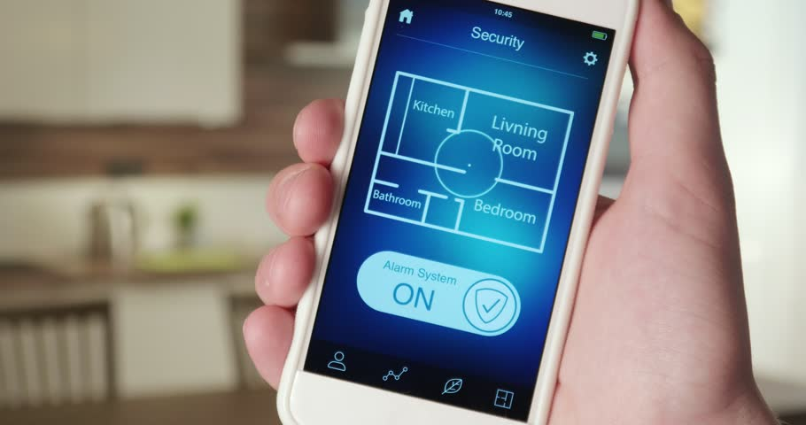 Turning on alarm system in the house using smartphone app | Shutterstock HD Video #31026340