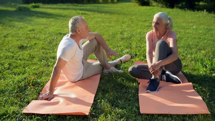 Joyful sporty aged couple resting after sport activities | Shutterstock HD Video #31034884