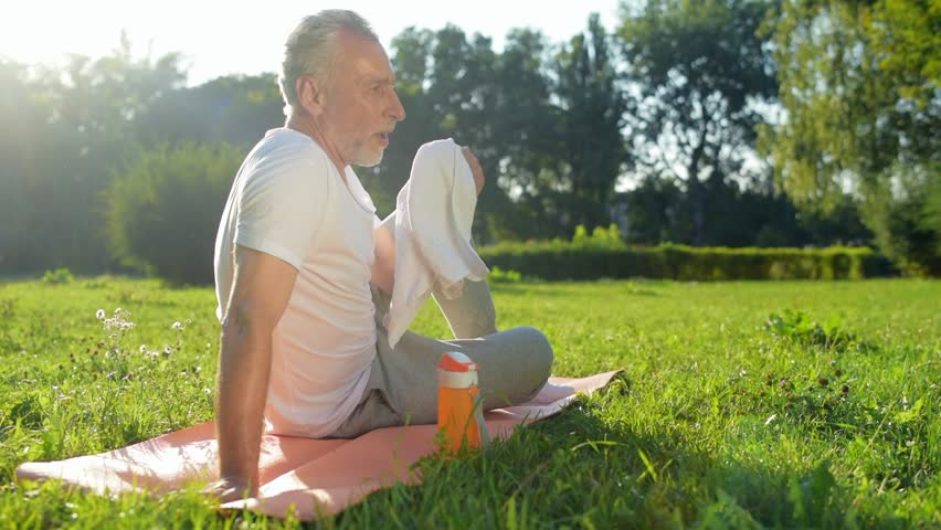 Positive aged man resting after sport exercises | Shutterstock HD Video #31034950