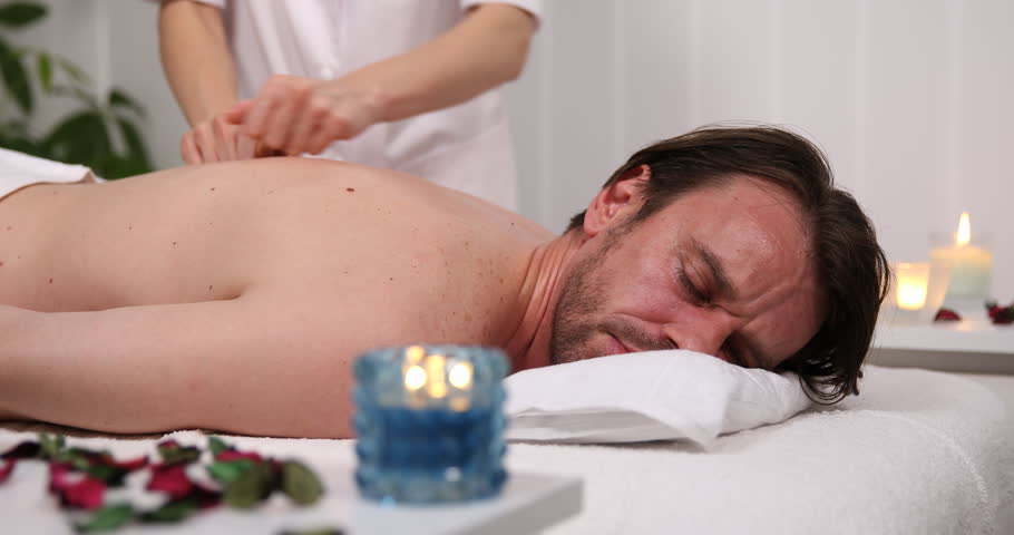 Kspa Client Sophisticated Man Lying On His Front Receiving A Back Body Massage