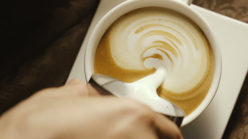 Pours milk into a coffee cup in a cafe | Shutterstock HD Video #31091545