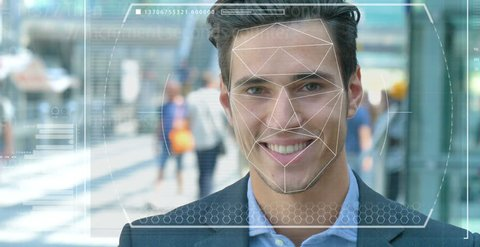 A businessman as bank and telephone bank protection has facial recognition, thanks to increased reality and futuristic technology. Concept of: cyber security, business, technology and future