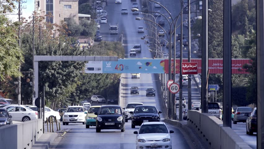 Amman, Jordan -May 2017 : Compound clip of the 3rd circle street at morning show the traffic  Amman, Jordan.