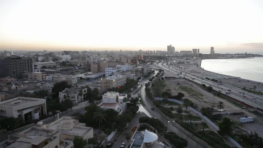 Tripoli, Libya, North Africa, at sunset, showing highways and the harbor.