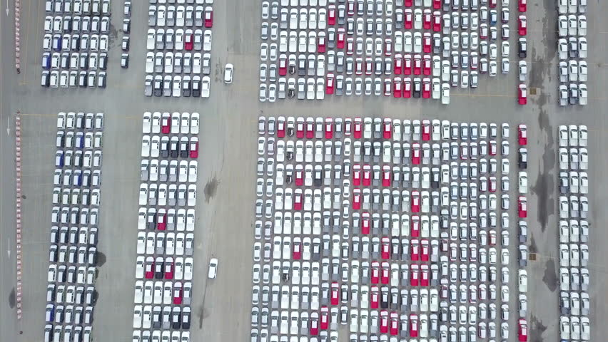 Aerial view of new car storage parking lot  Automobile export industry at deep water port | Shutterstock HD Video #31148950