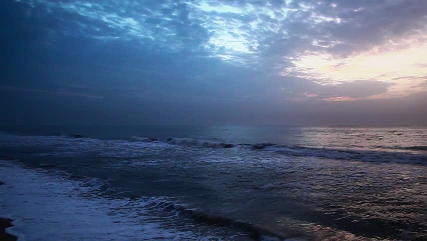 Pan shot of an ocean at sunset, Mahabalipuram, Kanchipuram District, Tamil Nadu, India
