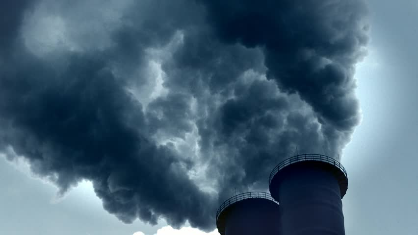 Dramatic smoke from a chimney. Air pollution from a coal-fired power station, close up and medium close shot.