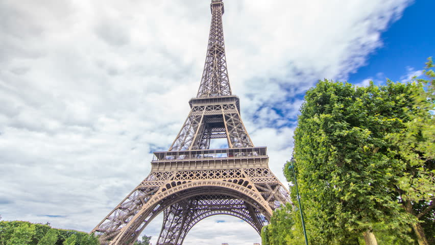 Champ de Mars and the Eiffel Tower timelapse hyperlapse in a sunny summer day. Paris, France. Green trees and cloudy sky, people walking around | Shutterstock HD Video #31227736