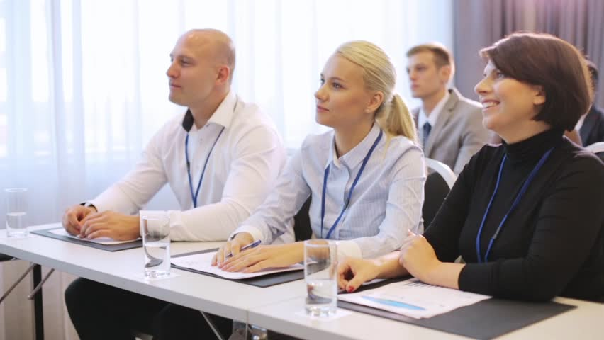 Business and education concept - group of people at international conference | Shutterstock HD Video #31241830