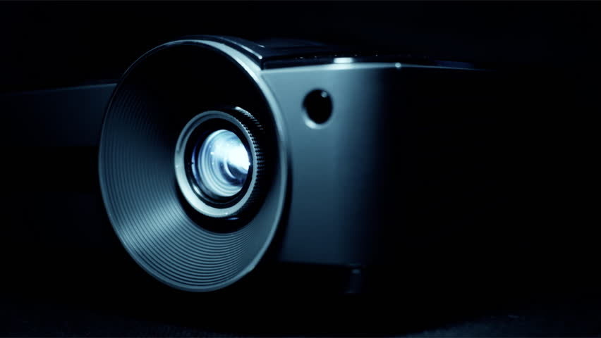 Front view of digital  film projector lens in action