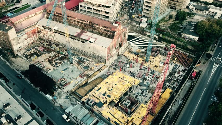 Aerial down view shot of a city construction site | Shutterstock HD Video #31355890