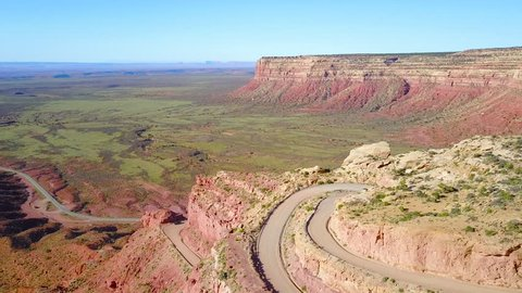 CIRCA 2010s - Moki Dugway, New Mexico - Aerial as a car travels on the dangerous mountain road of Moki Dugway, New Mexico, desert Southwest.