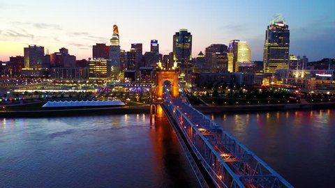 CIRCA 2010s - Cincinnati, Ohio - A beautiful evening aerial shot of Cincinnati Ohio with bridge crossing the Ohio River foreground.