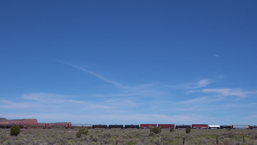 CIRCA 2010s - Southwest United States - An artistic view of a freight train passing through the desert of Arizona or New Mexico.