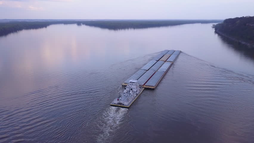 CIRCA 2010s - Mississippi River - A beautiful aerial of a barge traveling on the Mississippi River.