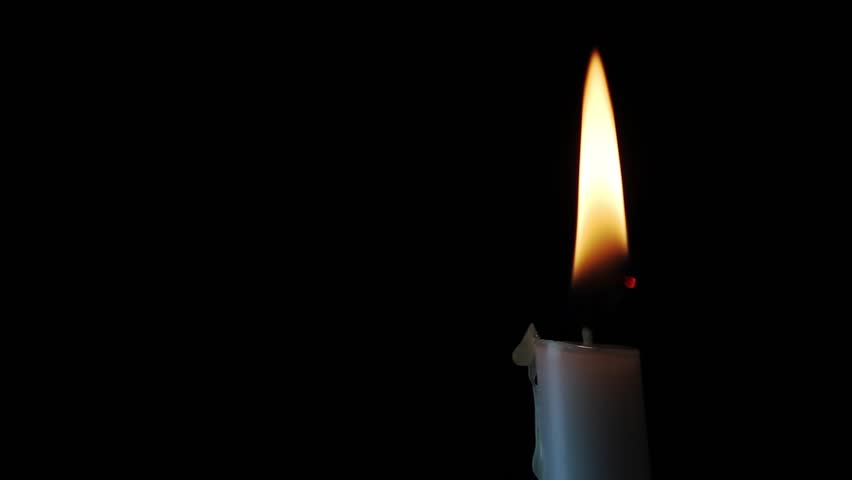 Looping, Single white candle with flickering flame shining into the darkness. Excellent text space! #3136849