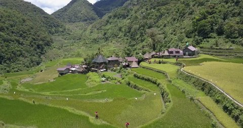 Aerial Drone Footage of a small village among the rice terraces of Bataad Bangaan Banaue in the Phillippines
