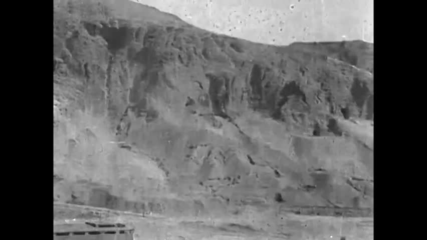 CIRCA 1920s - Egyptians excavate mortuary tombs at an archeological site in the cliffs of Deir el Bahri, in the Valley of the Nile, in Egypt, in 1920.
