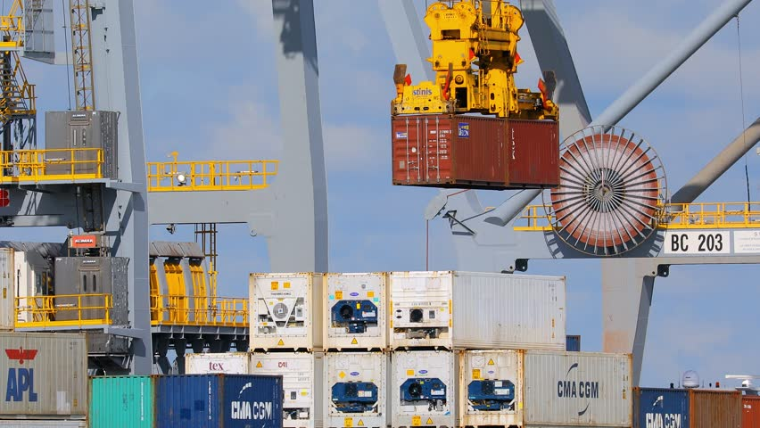 PORT OF ROTTERDAM, THE NETHERLANDS - SEPTEMBER 15, 2017: Crane moving containers in the highly automated Rotterdam World Gateway terminal