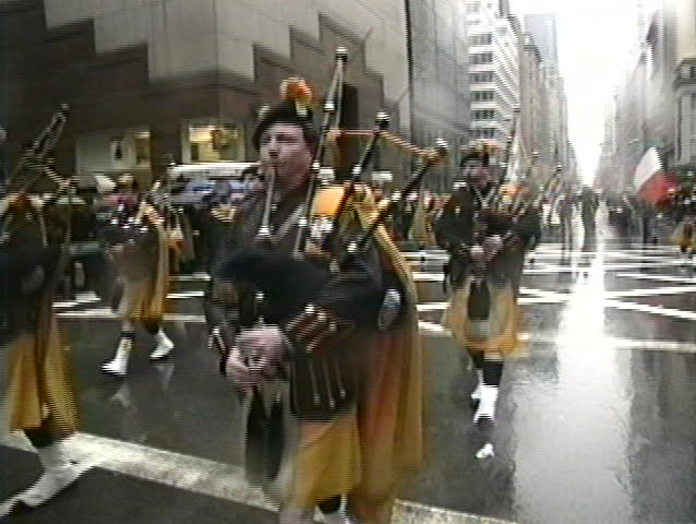 NEW YORK, USA - MARCH 17: Irish descendants march on 5th Avenue and play Irish music during rainy St. Patrick's Day parade, New York, USA March 17, 1995