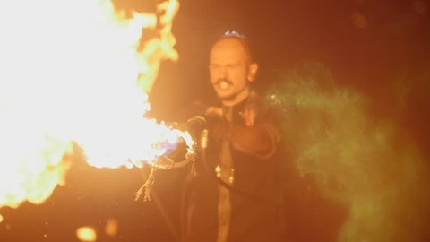 the stuntman releases a circle from the flamethrower. Action in slowmotion
